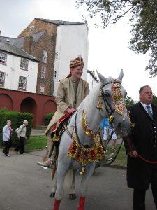 Groom arriving on horseback   Simplicity events   Asian Weddings