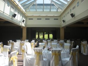 White chair covers with gold sash   Simplicity events   Asian Weddings
