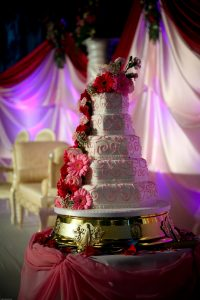5 tiered wedding cake with pink gerberas   Simplicity events   Asian Weddings